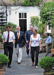 people walking through courtyard