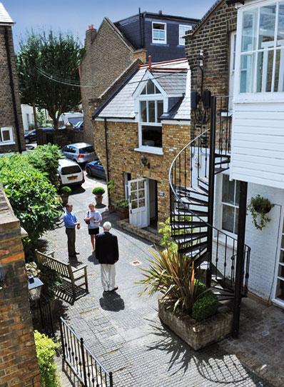 three-people-in-courtyard