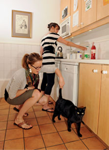 women in kitchen with cat