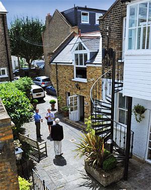 three people in courtyard